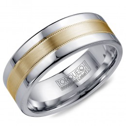 A Torque Ring In White Cobalt With A Brushed Yellow Gold Center And Milgrain Detailing.